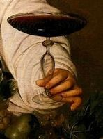 Close-up of Bacchus offering a glass of wine