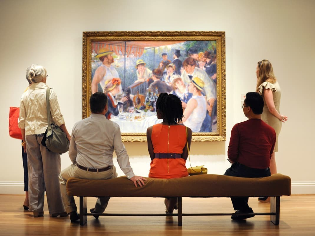 """Museum visitors enjoying """"The Luncheon of the Boating Party"""""""